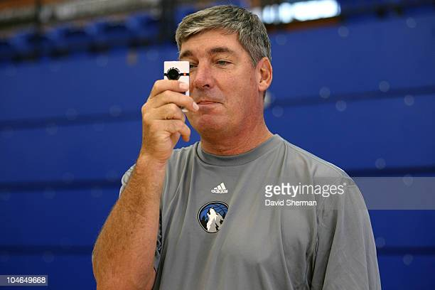 Assistant Coach Bill Laimbeer of the Minnesota Timberwolves takes video of media availability prior to team practice during 2010 NBA Europe Live on...
