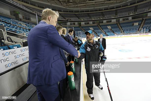 Assistant Coach Bob Boughner of the San Jose Sharks greets draft prospect Patrik Laine during media availablity for 2016 NHL Draft Top Prospects at...