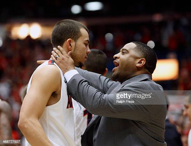 Assistant coach Book Richardson of the Arizona Wildcats talks to guard Gabe York of the Wildcats during a timeout of a college basketball game...