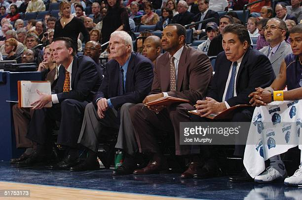 Assistant coach Brendan Brown, Head Coach Hubie Brown and Assistant Coaches Lionel Hollins and Tony Barone of the Memphis Grizzlies look on from the...