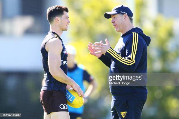 Assistant coach Brett Ratten speaks to Jaeger O'Meara of the Hawks during a Hawthorn Hawks AFL training session at Waverley Park on September 5 2018...
