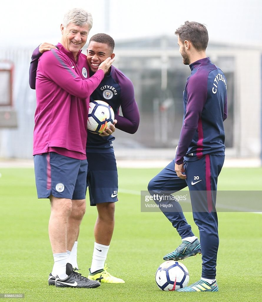 Assistant coach Brian Kidd hugs Gabriel Jesus during training at Manchester City Football Academy on August 25, 2017 in Manchester, England.