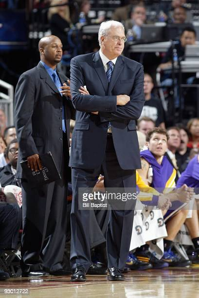 Assistant coach Brian Shaw and head coach Phil Jackson of the Los Angeles Lakers stand on the sideline during the game against the Houston Rockets on...