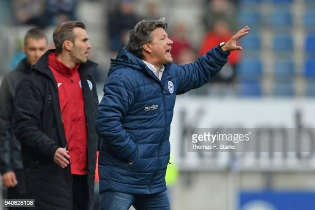 Assistant coach Carsten Rump and head coach Jeff Saibene reacts during the Second Bundesliga match between DSC Arminia Bielefeld and Holstein Kiel at...
