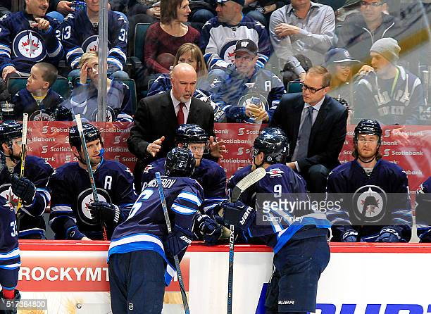 Assistant Coach Charlie Huddy of the Winnipeg Jets instructs Alexander Burmistrov and Andrew Copp at the bench during a second period stoppage...