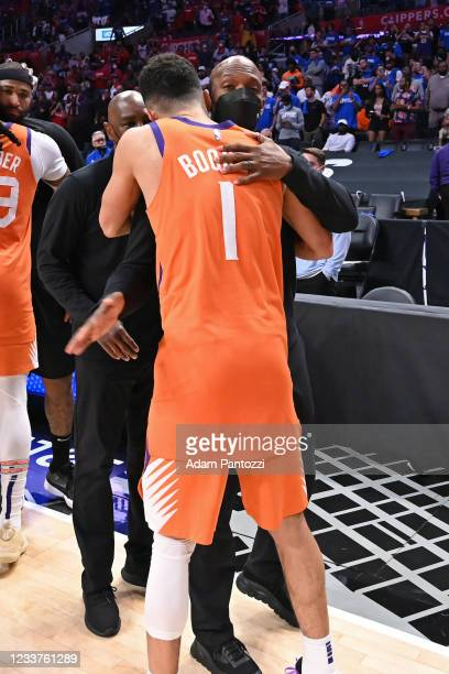 Assistant Coach, Chauncey Billups of the LA Clippers hugs Devin Booker of the Phoenix Suns after the game during Game 6 of the Western Conference...