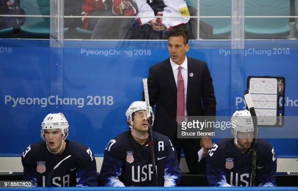 Assistant coach Chris Chelios looks on as Troy Terry of the United States Matt Gilroy of the United States and Bobby Sanguinetti of the United States...