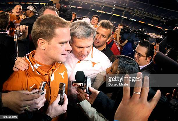 Assistant coach Chris Jesse and Head Coach Mack Brown of the Texas Longhorns are interviewed by media after the Texas Longhorns beat the Arizona...