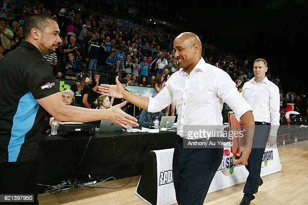 Assistant Coach CJ Bruton of Brisbane shakes hand with Head Coach Paul Henare of New Zealand after the round five NBL match between the New Zealand...