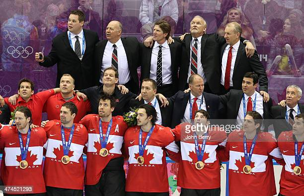 Assistant coach Claude Julien and head coach Mike Babcock of Canada look on during the medal ceremony of the Men's Ice Hockey Gold Medal match...