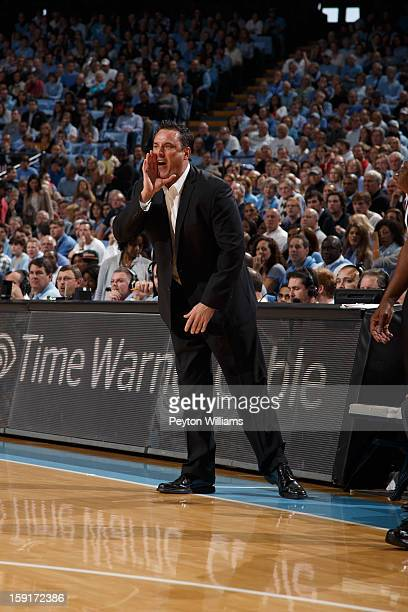 Assistant coach coach Heath Schroyer of the UNLV Rebels coaches during a game against the North Carolina Tar Heels on December 29 2012 at the Dean E...