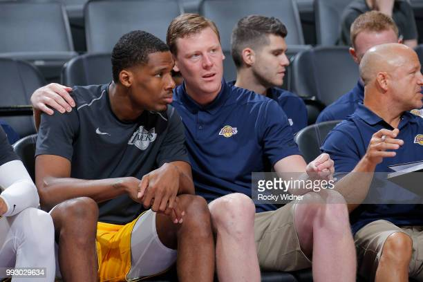 Assistant Coach Coby Karl of the Los Angeles Lakers speaks with Nick King of the Los Angeles Lakers during the game against the Golden State Warriors...
