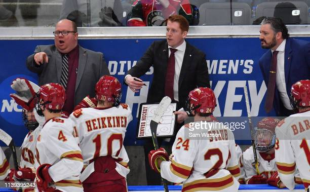 Assistant coach Dallas Ferguson and head coach David Carle of the Denver Pioneers give instructions their team during the NCAA Division I Men's Ice...