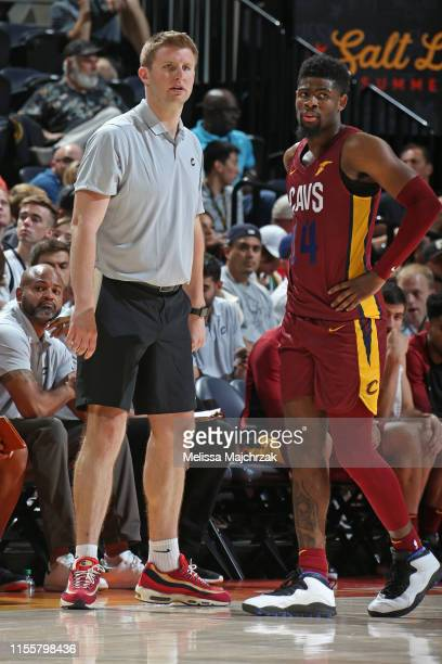 Assistant coach Dan Geriot, and Malik Newman of the Cleveland Cavaliers looks on during the game against the Utah Jazz on July 2, 2019 at...