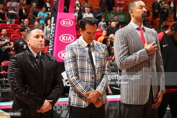 Assistant Coach Dan Graig Head Coach Erik Spoelstra and Assistant Coach Juwan Howard of the Miami Heat stand for the national anthem before the game...