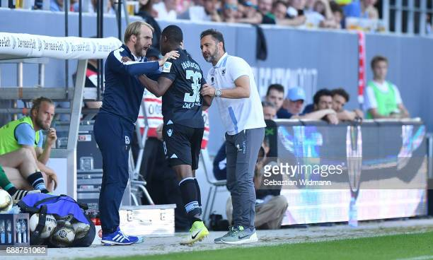 Assistant coach Daniel Bierofka and head coach Vitor Pereira talk to Romuald Lacazette of 1860 Muenchen after his substitution during the Second...