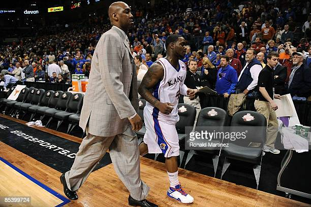 Assistant coach Danny Manning and Sherron Collins of the Kansas Jayhawks walk off the court after a loss to the Baylor Bears during the Phillips 66...