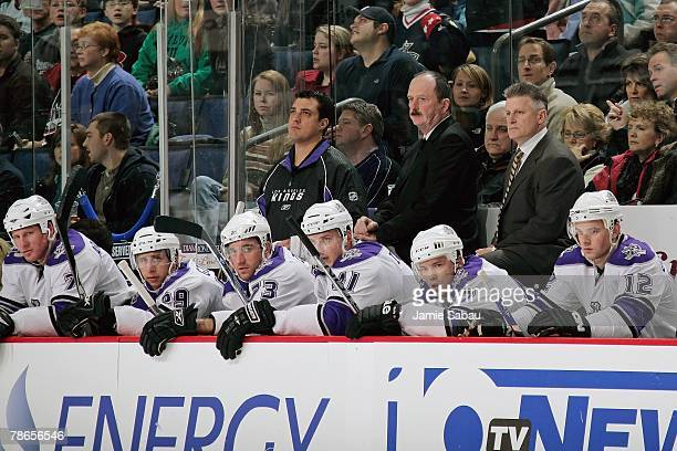 Assistant Coach Dave Lewis left and Head Coach Marc Crawford right of the Los Angeles Kings watch the game against the Columbus Blue Jackets on...