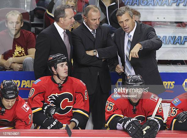 Assistant Coach Dave Lowry Head Coach Brent Sutter and Assistant Coach Craig Hartsburg of the Calgary Flames make a plan against the Phoenix Coyotes...