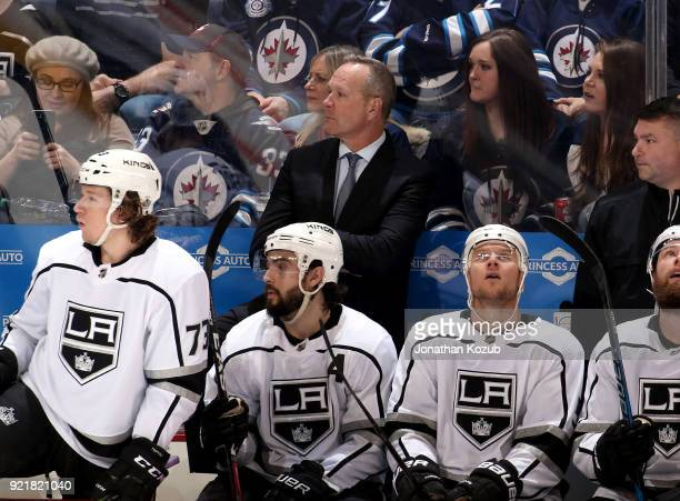 Assistant Coach Dave Lowry of the Los Angeles Kings looks on from the bench during second period action against the Winnipeg Jets at the Bell MTS...