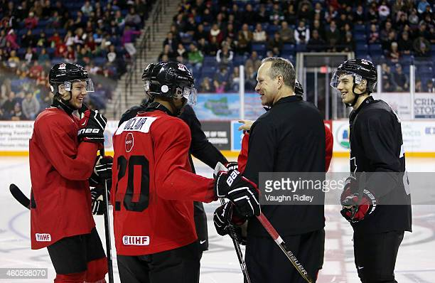Assistant Coach Dave Lowry shares a joke with Sam Reinhart Anthony Duclair and Shea Theadore during the Canada National Junior Team practice at the...