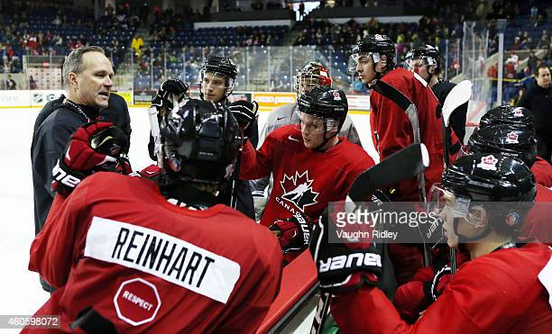 Assistant Coach Dave Lowry talks to the forwards during the Canada National Junior Team practice at the Meridian Centre on December 17 2014 in St...