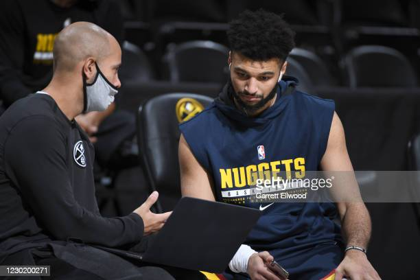 December 18: Assistant Coach David Adelman and Jamal Murray of the Denver Nuggets talk prior to a preseason game against the Portland Trail Blazers...