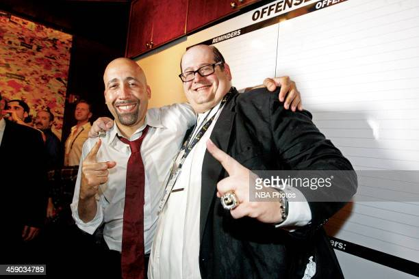 Assistant coach David Fizdale and senior vice president/general manager Andy Elisburg poses with the Larry O'Brien Trophies the Miami Heat have won...