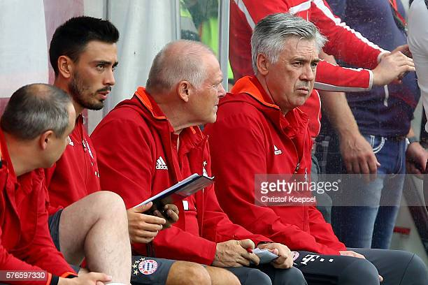 Assistant coach Davide Ancelotti assistant coach Herann Gerland and head coach Carlo Ancelotti of Bayern Muenchen sit on the bench during the...