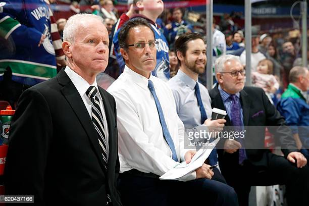 Assistant coach Doug Jarvis assistant coach Doug Lidster video coach Ben Cooper and assistant coach Perry Pearn of the Vancouver Canucks look on from...