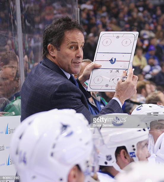 Assistant coach Doug Lidster give players instructions during the third period against the New York Islanders at the Barclays Center on January 17...