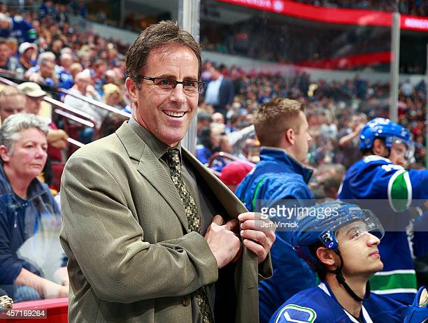 Assistant coach Doug Lidster of the Vancouver Canucks looks on from the bench during their NHL game against the Edmonton Oilers at Rogers Arena...
