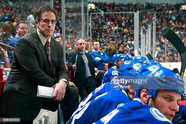 Assistant coach Doug Lidster of the Vancouver Canucks looks on from the bench during their game against the Carolina Hurricanes at Rogers Arena...