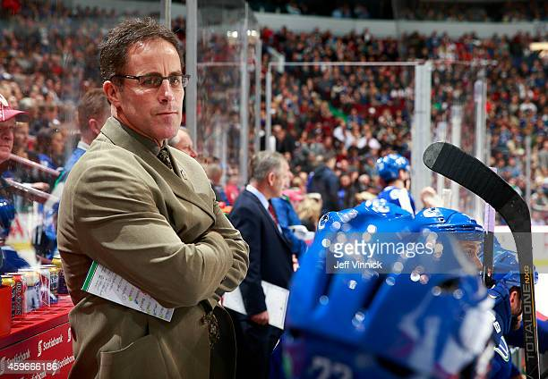 Assistant coach Doug Lidster of the Vancouver Canucks looks on from the bench during their NHL game against the New Jersey Devils at Rogers Arena...
