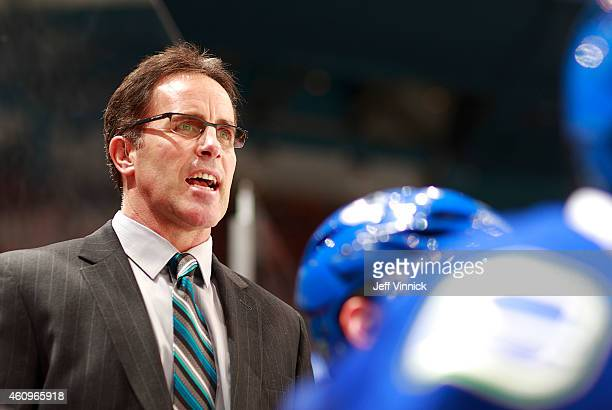 Assistant coach Doug Lidster of the Vancouver Canucks looks on from the bench during their NHL game against the Dallas Stars at Rogers Arena December...