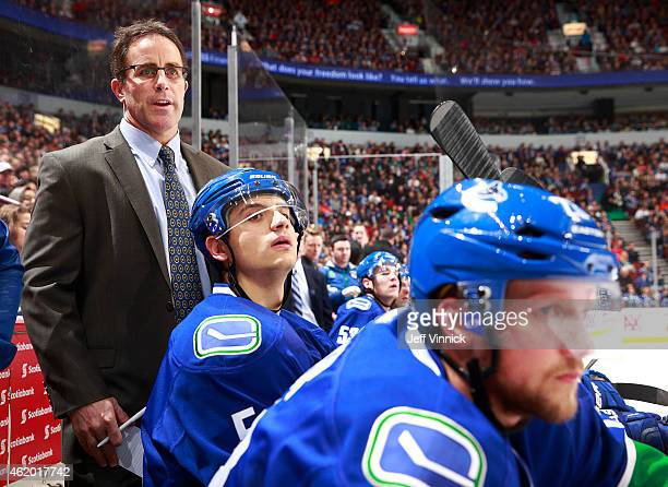 Assistant coach Doug Lidster of the Vancouver Canucks looks on from the bench during their NHL game against the Florida Panthers at Rogers Arena...