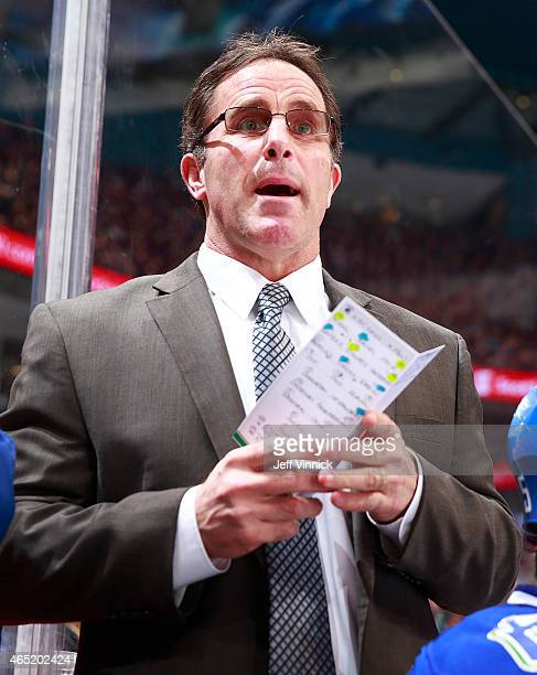 Assistant coach Doug Lidster of the Vancouver Canucks looks on from the bench during their NHL game against the St Louis Blues at Rogers Arena March...