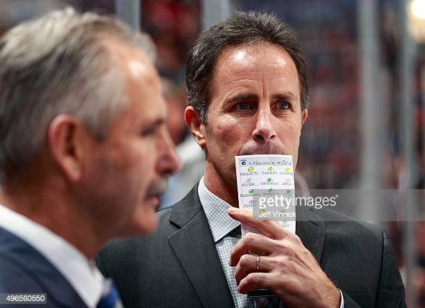 Assistant coach Doug Lidster of the Vancouver Canucks looks on from the bench during their NHL game against the Montreal Canadiens at Rogers Arena...