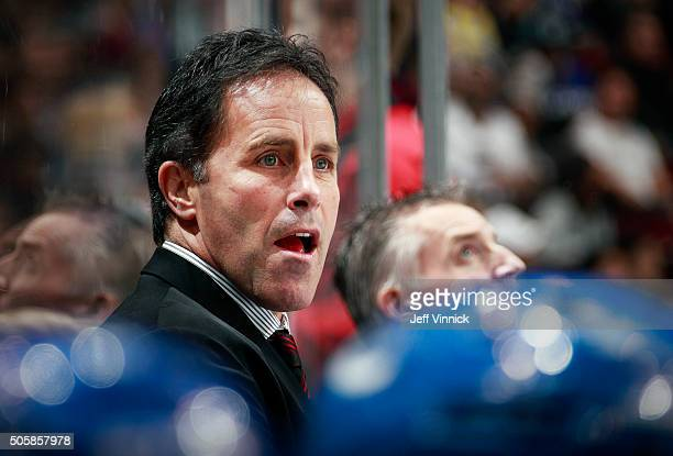 Assistant coach Doug Lidster of the Vancouver Canucks looks on from the bench during their NHL game against the Los Angeles Kings at Rogers Arena...