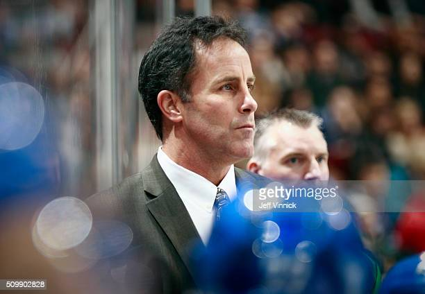 Assistant coach Doug Lidster of the Vancouver Canucks looks on from the bench during their NHL game against the Nashville Predators at Rogers Arena...
