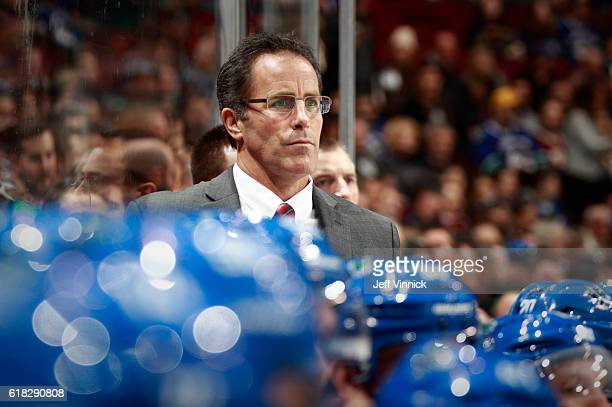 Assistant coach Doug Lidster of the Vancouver Canucks looks on from the bench during their NHL game against the Buffalo Sabres at Rogers Arena...