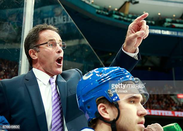 Assistant coach Doug Lidster of the Vancouver Canucks looks on from the bench during their NHL game against the Arizona Coyotes at Rogers Arena...