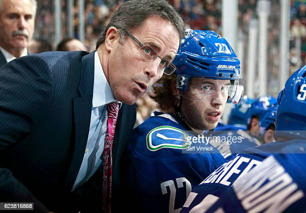 Assistant coach Doug Lidster of the Vancouver Canucks talks to Ben Hutton during their NHL game against the Dallas Stars at Rogers Arena November 13...