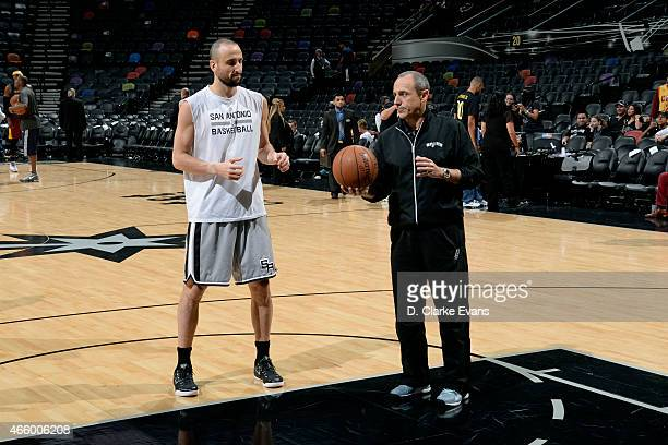 Assistant coach Ettore Messina helps Manu Ginobili of the San Antonio Spurs warm up before a game against the Cleveland Cavaliers at the ATT Center...