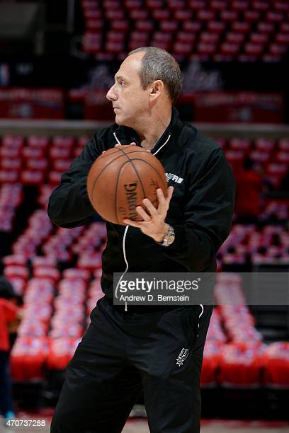 Assistant Coach Ettore Messina helps the team warm up before a game against the Los Angeles Clippers in Game Two of the Western Conference...