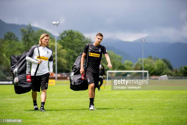 Assistant Coach Eugen Polanski and Florian Neuhaus are seen during the Borussia Moenchengladbach Training Camp on July 14, 2019 in Rottach-Egern,...