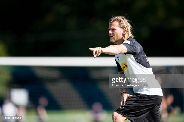 Assistant Coach Eugen Polanski gives instructions during a Training session of the Borussia Moenchengladbach Training Camp on July 15, 2019 in...