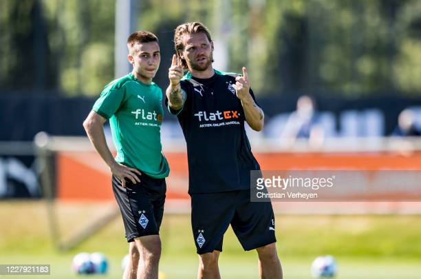 Assistant Coach Eugen Polanski gives instructions to Rocco Reitz during a training session of Borussia Moenchengladbach at Borussia-Park on August...