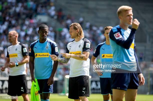 Assistant Coach Eugen Polanski of Borussia Moenchengladbach talks to Mamadou Doucoure during a Training Session of Borussia Moenchengladbach at...