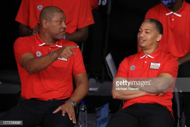Assistant coach for the LA Clippers Tyronn Lue talks with Doc Rivers of the LA Clippers during the third quarter against the Denver Nuggets in Game...